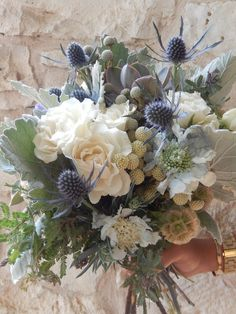 Flora Fetish LLC - Austin Florists - Sage green, ivory, and pale purple bouquet of flowers and dusty miller