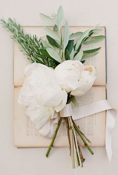 Romantic Posy of Peonies & Rosemary. A romantic posy comprised of cream peonies, olive leaf, and rosemary.