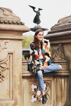 Andy Torres wearing an H&M Faux fur coat, Levis jeans and Saint Laurent bag in Central Park.