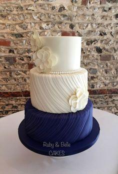 Beautiful Silk Pleats wedding cake design, in navy & ivory. We LOVE this cake!