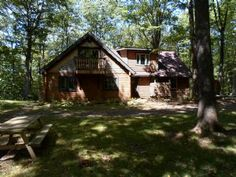 """Stopping by Woods"" our vacation rental home in Deep Creek Lake MD is minutes from Deep Creek Lake activities. Short distance to Wisp Ski Resort. Comforting wood 'Buck Stove' to gather around Park-Like outside setting - firepit, trails, grounds Equally Perfect for romantic get-a- ways or family outings."