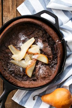 Snow day? Try this decadent brunch recipe for Chocolate Dutch Baby with Caramelized Pears