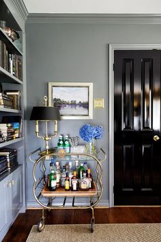 These home bar designs are like nothing you've ever seen! Luxe, chic, unique, and simply stylish, they may inspire you for great design deeds. Bandeja Bar, Coffee Bar Design, Black Interior Doors, Black Doors, Bar Cart Decor, Living Room Seating, Painted Doors, Painted Walls, Bar Furniture
