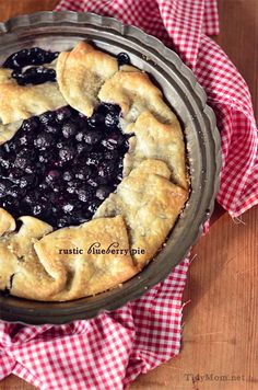 Rustic Blueberry Pie For the Crust: 1-1/4 cups flour 1/2 teaspoon salt 1 tablespoon sugar 1/2 cup cold butter (1 stick) 1/8-1/4 cup ice water For Pie Filling: 2 cups blueberries (fresh or frozen) 1/2 cup sugar 1-2 Tablespoons flour (depending how juicy they are) 1 Tablespoon lemon juice 400 for 30 min. easy peasy.