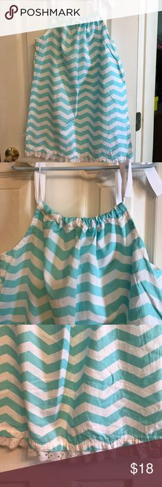 Girls summer pillowcase dress NWOT.  Never worn.  Locally made girls sundress. Ribbon tie closures at shoulders. Very cute aqua and white chevron print. Trimmed with white eyelet lace. Size 8. Purchased from children's boutique in Richmond Virginia. Dresses