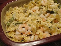Deep covered baker shrimp or chicken with asparagus Alfredo