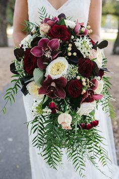 Cascading burgundy orchid and rose wedding bouquet | Bec Matheson Photography