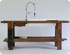 an old carpenter bench w/sink, what a great idea! Kitchen or bath or potting bench!
