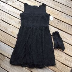 Black lace dress Black lace dress with belt, new with tags jcpenney Dresses