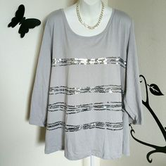 "Light Grey Sequin Stripe Accent Top This nice light grey top has strips of silver sequins going across the front. It has 3/4 sleeves, and is very comfy. Material is cotton / polyester blend.  Size is 3X Bust: Approximately 55"" Length: Approximately 28""  In great condition. Bay Studio  Tops"