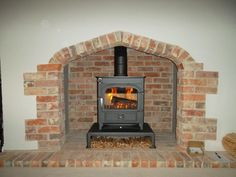 Photo gallery of our New Forest wood burning stoves Woodworking Store, Learn Woodworking, Brick Fireplace, Fireplace Ideas, Country Cottage Interiors, Painted Wood Walls, Dark Wood Floors, Rustic Fireplaces, Wood Pallet Signs