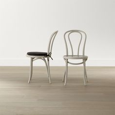 In 1859, Michael Thonet introduced the concept of bending wood with steam to design the iconic bentwood chair. Today, our bent beechwood Vienna dining chair is produced in one of the original Thonet factories in Europe. <NEWTAG/><ul><li>Bent beechwood frame and seat in dove grey lacquer finish</li><li>Engineered wood seat</li><li>Polyester and foam cushion with 100 percent cotton twill cover and tie attachments (optional; sold separately)</li><li>Made in multiple countries</li></ul><br />