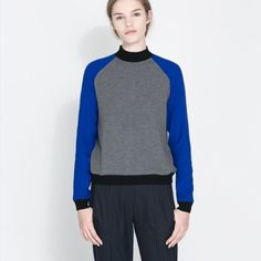 Zara long silk sleeve sweater sweatshirt medium M Zara size medium royal blue black and grey long sleeve sweater. Also available in size small in a separate listing. The heather grey body of the sweater is made with a soft stretchy comfortable sweatshirt material. The royal blue sleeves are made of super soft lightweight silk and the black accents are made with a knitted sweater material. This has a mock turtle neck design with a zipper along the center back collar. Zara Sweaters