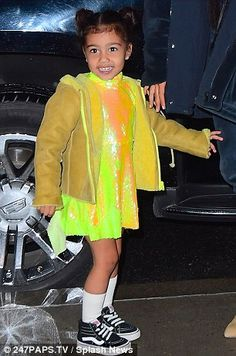 Standing out:North wore a bright yellow sequined dress with a mock turtleneck