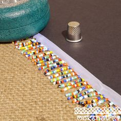 Beaded trim with fringe of multicoloured rainbow seed beads attached to a white satin tape.  This trim provides lots of movement and would be ideal for a Indian / Native American costume or for a boho fringe. Beaded Trim, Fringe Trim, White Satin, Haberdashery, Seed Beads, Turquoise Bracelet, Rainbow, Boho, Lace