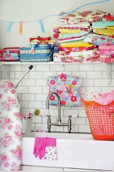 Pretty and colorful laundry room pastel plastic cloths pins hung on clothsline<3
