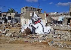 """""""A local man came up and said 'Please – what does this mean?' I explained I wanted to highlight the destruction in Gaza by posting photos on my website – but on the internet people only look at pictures of kittens"""" - Bansky"""