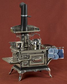 Buck's Stove & Range Co. cast iron and nickel Buck's Brilliant toy stove, h. Such an amazing toy stove. Antique Wood Stove, How To Antique Wood, Foyers, Buck Stove, Cooking Stove, Cooking Fish, Cast Iron Stove, Vintage Stoves, Stove Fireplace