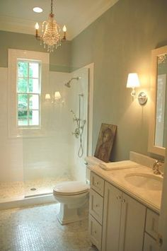 Love the chandelier in the bathroom