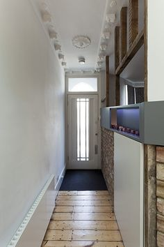 Front entrance hallway, exposed brick, contemporary features, Victorian molding on ceiling