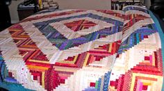 This log cabin quilt was made for a king size bed -- all from the quilter's stash.