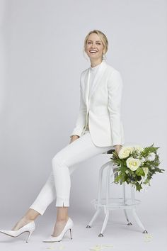 Shop our women's white tuxedo jacket, perfect for the modern bride! A crisp look offering style, comfort, and the perfect fit. Shop our women's tux collection today! Wedding Pantsuit, Sheath Wedding Gown, Wedding Dresses, Wedding Tuxedos, Wedding Poses, White Tuxedo Jacket, Tuxedo Dress, Tuxedo Cake, Tuxedo Pants