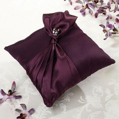 $18.99 Purple Satin Wedding Ring Bearer Pillow. Might get this one.