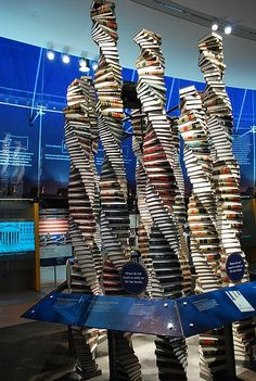 The Tower of Law exhibit at the National Constitution Center (http://constitutioncenter.org) in Philadelphia. Columns of twisting law books commemorate the Sixth Amendment. [ #books #installation #sculpture #tower ]