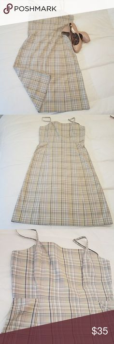 J. Crew plaid sundress size 8 100% cotton J. Crew plaid sundress size 8 100% cotton. And almost celery green plaid with blue and tan on this very pretty J crew dress it's a hundred percent cotton has a zipper back and the spaghetti straps have elastic stretch on the back of them. I am 5 foot 9 in this dress hits me at the knees, very good condition. Waist 15 inches across lying flat  length from top of strap unstretched to bottom of dress  approximately  42 inches.🌴 J. Crew Dresses Midi