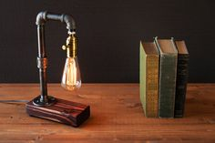 Bedside Steampunk Pipe Lamp - Table Lamps -  ☆CRAFTSMEN NOTES: Industrial Rustic Edison table – desk lamp. This is a well made sturdy piece that will last you for years! The Edison bulb pipe lamp adds the perfect Steampunk Industrial feel balanced with the finished wood. Pick from 3 wood finishes for this piece to fit just perfectly... #Bedside #Diy #Edison #Farmhouse #Handmade #Industrial #Metal #Patio #Recycled #Steampunk #Tablelamp #Vintage