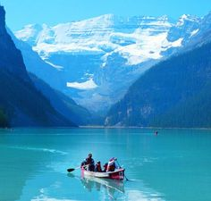 Canoeing, surrounded by the mountains.
