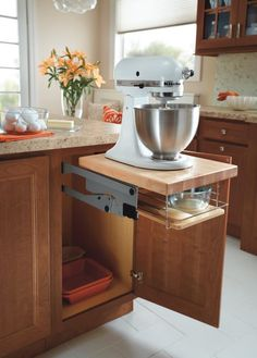 Homecrest's Base Mixer Cabinet frees up counter space yet keeps large, chef-size mixers within easy reach.