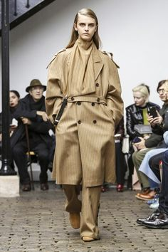 Nehera's Samuel Drira is known for his tailored pieces in asymmetric cuts and his bold take on oversize clothing.This season's outstanding looks included workwear pants and a pi...