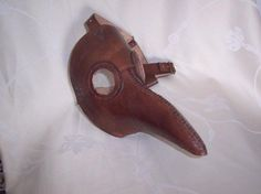 Hand made leather plague doctor mask based in the 14th century plague doctors from Steam Generation   Made using 2.5mm veg tan leather, brass rivets / buckles, hand stitched / dyed