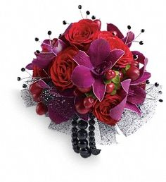 Flirt with fame in this feminine arrangement of exotic orchids, roses and hypericum.  Purple dendrobium orchids, red spray roses and red hypericum with black rhinestone accents.