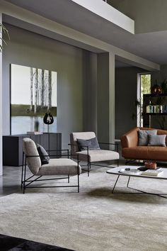 #Kyo #armchair - the seat and backrest are pratically suspended, supported by a slim frame in black finish metal.