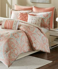 Give your bedroom a refresh with this bright coral comforter featuring a cotton-blend construction and intricately-embroided pillows.FeaturesProduct Details