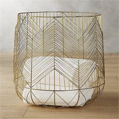 I love this basket SO much!!!  Shop blanche metal baskets.   Thin iron wire sculpts a modern deco design.  Handmade open weave stylishly stores magazines, remotes, towels, toys––anything that needs a chic place to land.