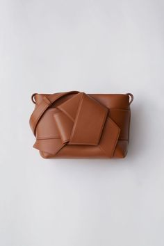 cddc28f099e6 Acne Studios Musubi Handbag cognac brown is a functional bag based on the  knot in a traditional Japanese obi sash.