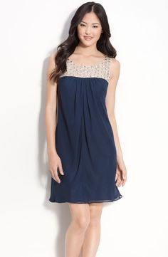 https://www.lyst.co.uk/clothing/js-boutique-embellished-chiffon-mesh-trapeze-dress-navy-nude/?product_gallery=3341352
