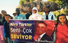 """Afro-Turks from the districts of Ortaca, Dalaman and Köycegiz in the southwestern province of Mugla got together to celebrate Obama's success. They hung banners declaring """"Barack Obama, we love you very much"""" during the solidarity event, held at Toprak Ana (Mother Earth) in Ortaca, Turkey."""