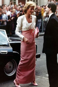 Princess Diana arriving at the Coliseum wearing a white and pink evening dress