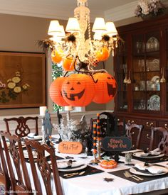 decorate your chandelier with beaded garland, feathers and even lanterns #Halloween