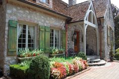 French Country with striking green shutters...