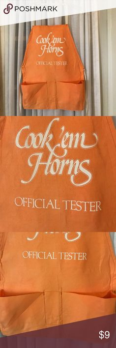 Child's Cook 'me Horns Apron Tx Longhorns orange This is a cute Apron for girls and boys. Orange with white lettering. Two pockets. Cook 'me Horns Official Tester. It has a tiny hole as shown on the picture. Otherwise in good condition. Other