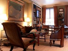 Masculine library feeling to Bunny Williams' Drawing Room ~ An ivory-inlaid Art Deco chair faces the 18th century lacquer coffee table in her NYC home.