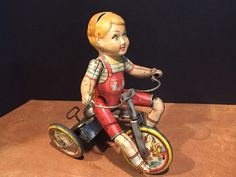 """It is the """"Kiddy Cyclist"""" made by Unique Art MFG. Co. c. 1930s. Measures about 9"""" tall, 7.5"""" long, and 4.25"""" wide. I wound it up to test it, and it works some of the time. It moves forward and the boy steers the bike in a zig-zag pattern. 
