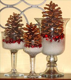 Instead of one large centerpiece do a few mini ones. Use goblets or hurricane vases, fill with epson salts and cranberries and top with a pinecone.