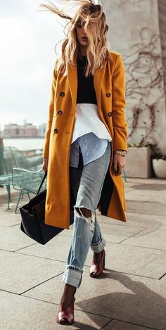fall layered outfit idea to try right now : coat + bag plsu heels + rips + shirt + crop top