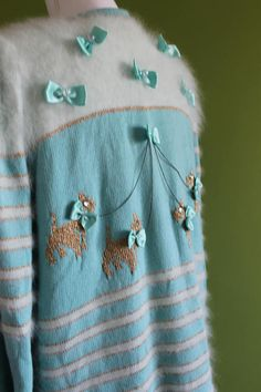Quirky Vintage Puppy Cardigan Knitwear Fluffy Unique vintage cardigan Gold details Shoulder pads Dog lover Vintage baby blue bows Oversized This is one of my favorite pieces. This beautiful fluffy cardigan in a ligh blue color is so soft and fluffy, and at the same time very quirky and unique.  Brand Marlis Muller